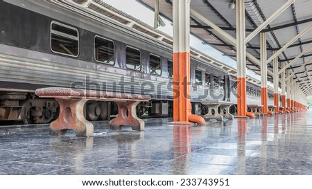 Passenger platform at the day on the railway station. - stock photo