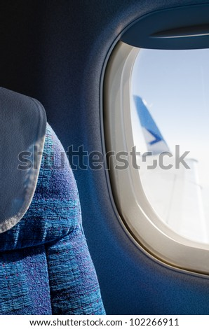 Passenger seat in an airplane - stock photo