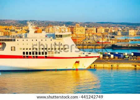 Passenger ship in Civitavecchia sea port at sunset. Italy - stock photo