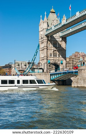 Passenger ship is about to pass under Tower Bridge, London, UK - stock photo