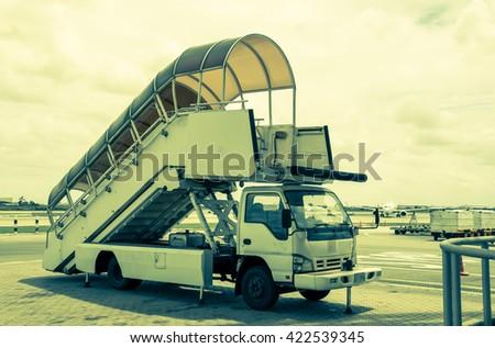 passenger step vehicle for Ground service,suvarnabhumiairport vintage tone - stock photo