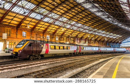 Passenger train at Bristol Temple Meads Railway Station, England - stock photo