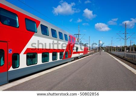 Passenger train departure - stock photo