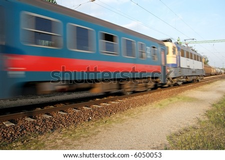 Passenger train going fast with motion blur - stock photo