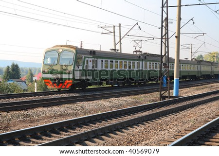 passenger train on electric railway in suburb