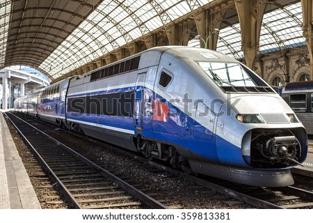 Passenger train stands at Nice train station in a summer day in Nice, France - stock photo