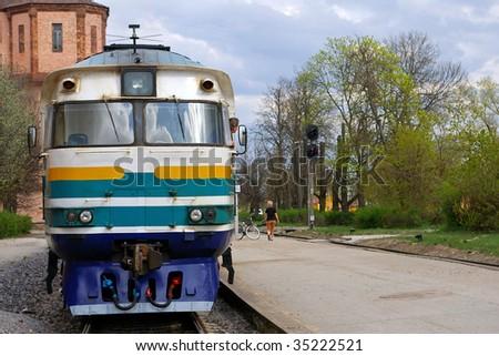 passenger train waiting at station - stock photo