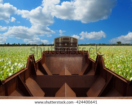 passenger trains and industry container railroads running on railways track against summer meadow with blue sky use for land transport and logistic business - stock photo
