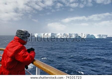 Passenger viewing beautiful iceberg at Antarctica. - stock photo