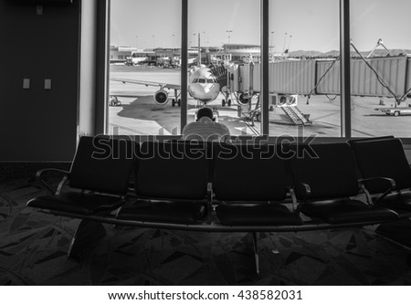 Passenger waiting to board a flight in airport, Black and White - stock photo