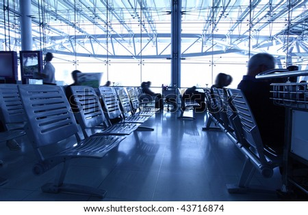 Passengers at airport, toned in blue color