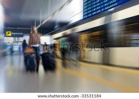 Passengers at the Airport Subway Moving with Blur - stock photo