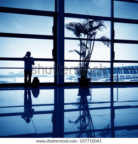 Passengers at the airport window to call. - stock photo