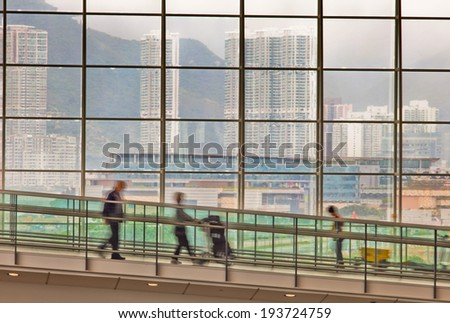 Passengers at the airport with bags go to registration - stock photo