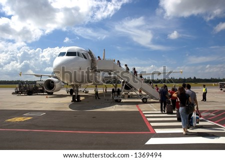 Passengers boarding the Plane - stock photo