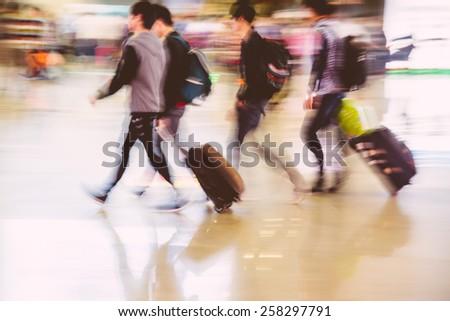 passengers crowd rushing at big city station. - stock photo