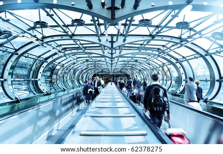 Passengers entering / leaving airport terminal - stock photo