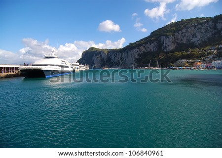 passengers ferry and yachts at the port of Capri island