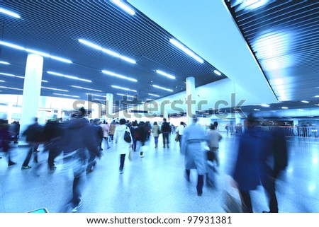 Passengers in a hurry to walk the modern subway station - stock photo