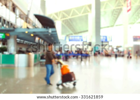 Passengers in airport de focused abstract background - stock photo
