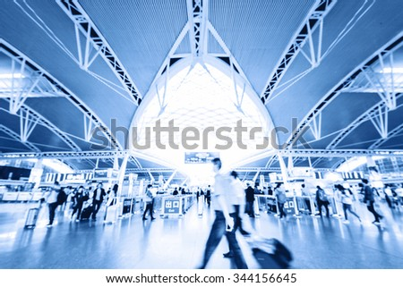 Passengers in an airport - stock photo