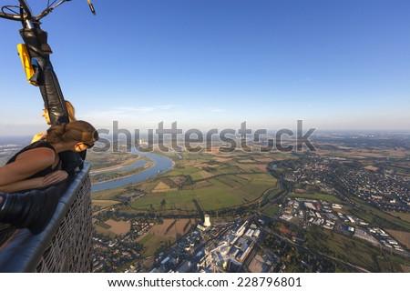 Passengers in Hot Air Balloon flying over the Lower Rhine Region of Germany - Rheinberg, North Rhine-Westfalia, Germany, Europe - stock photo
