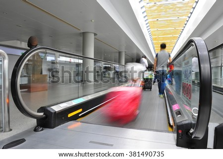 Passengers in Shanghai Pudong International Airport Airport - stock photo