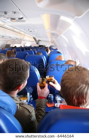 passengers in the aircraft from behind - stock photo