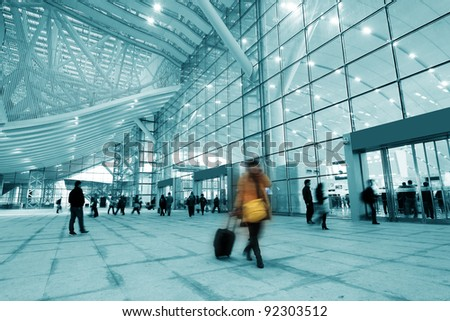 Passengers in the airport interior - stock photo