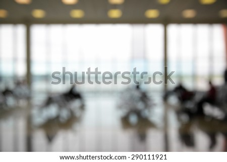 Passengers in the airport lounge out of focus - stock photo