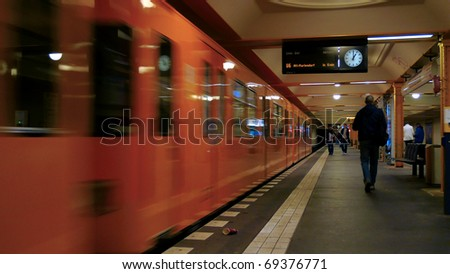 Passengers late for subway train - stock photo