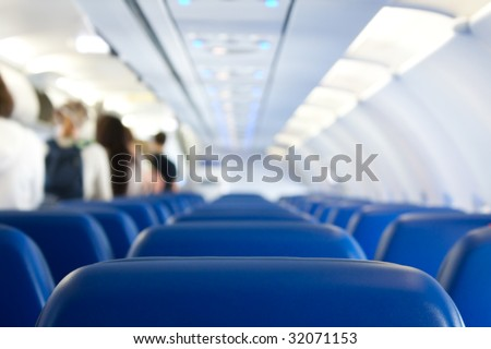 passengers leaving plane after successful landing - stock photo