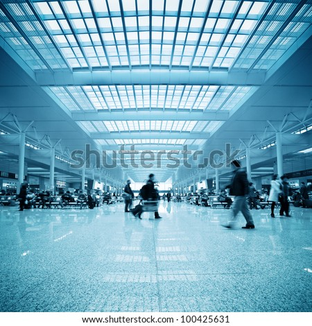 passengers motion blur in shanghai train station waiting hall - stock photo