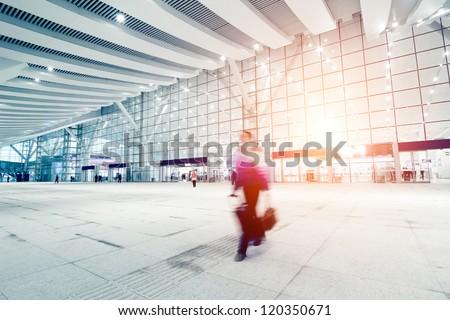 passengers motion blur in shenzhen train station waiting hall - stock photo