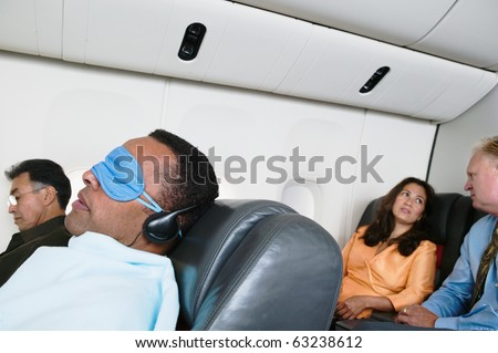 Passengers on airplane - stock photo