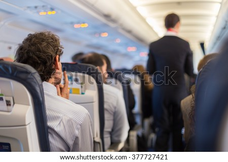 Passengers on the airplane. - stock photo