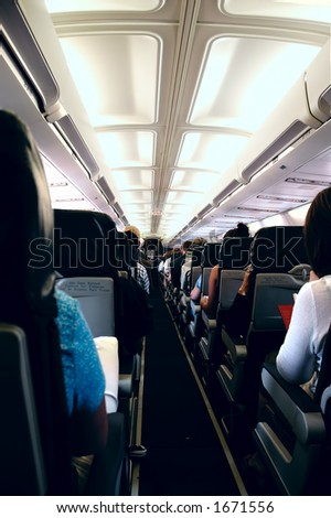 Passengers onboard an airplane - stock photo