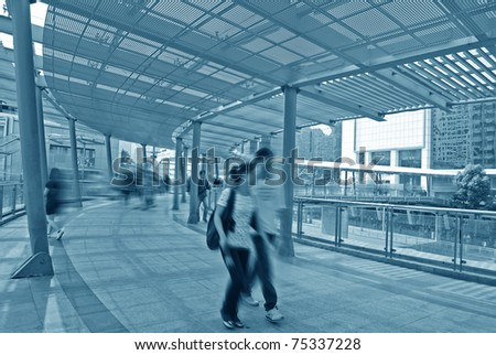 Passengers quickly through the silhouette of a footbridge - stock photo