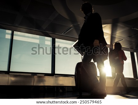 passengers silhouettes at the airport. concept about traveling - stock photo