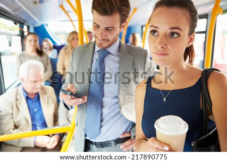Passengers Standing On Busy Commuter Bus - stock photo