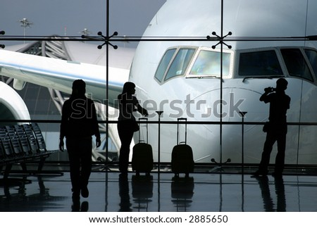 Passengers waiting for the airplane in the airport - stock photo