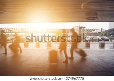 Passengers walking in a hurry