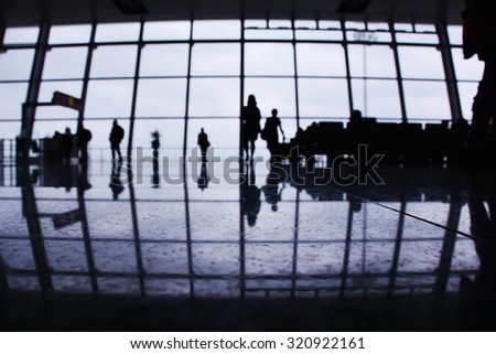 Passengers walking to the gate, Interior of an Airport Terminal Waiting Area, Blurred concept