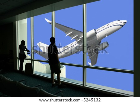 Passengers watching airplane while waiting for the flight - stock photo