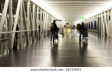 Passengers with luggage at Schipol Airport in Amsterdam (Holland) - stock photo