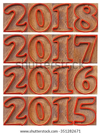 passing and incoming years (2015, 2016, 2017), 2018)  in letterpress wood type block, stained by red inks, isolated on white - stock photo