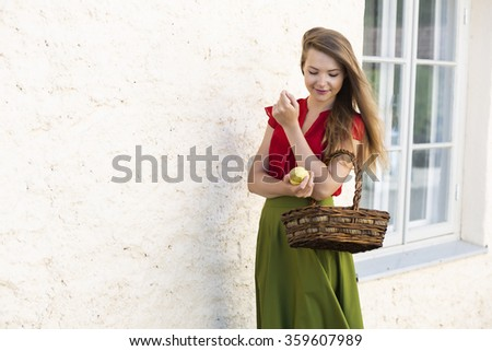 Passing by with basket of juicy apples - stock photo
