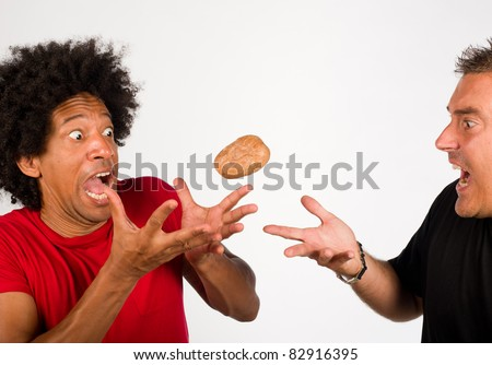 Passing on the hot potato, a concept - stock photo