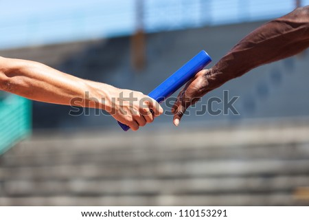 Passing the Relay Baton - stock photo