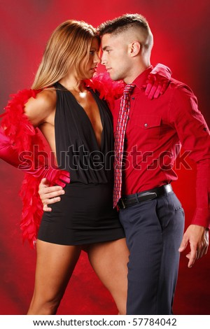 Passion couple on red background - stock photo